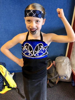 Emily Larkins Author's eldest daughter in her traditional costume for Otago Polyfest 2019. Click to watch and hear her school's performance at 0:2:20.