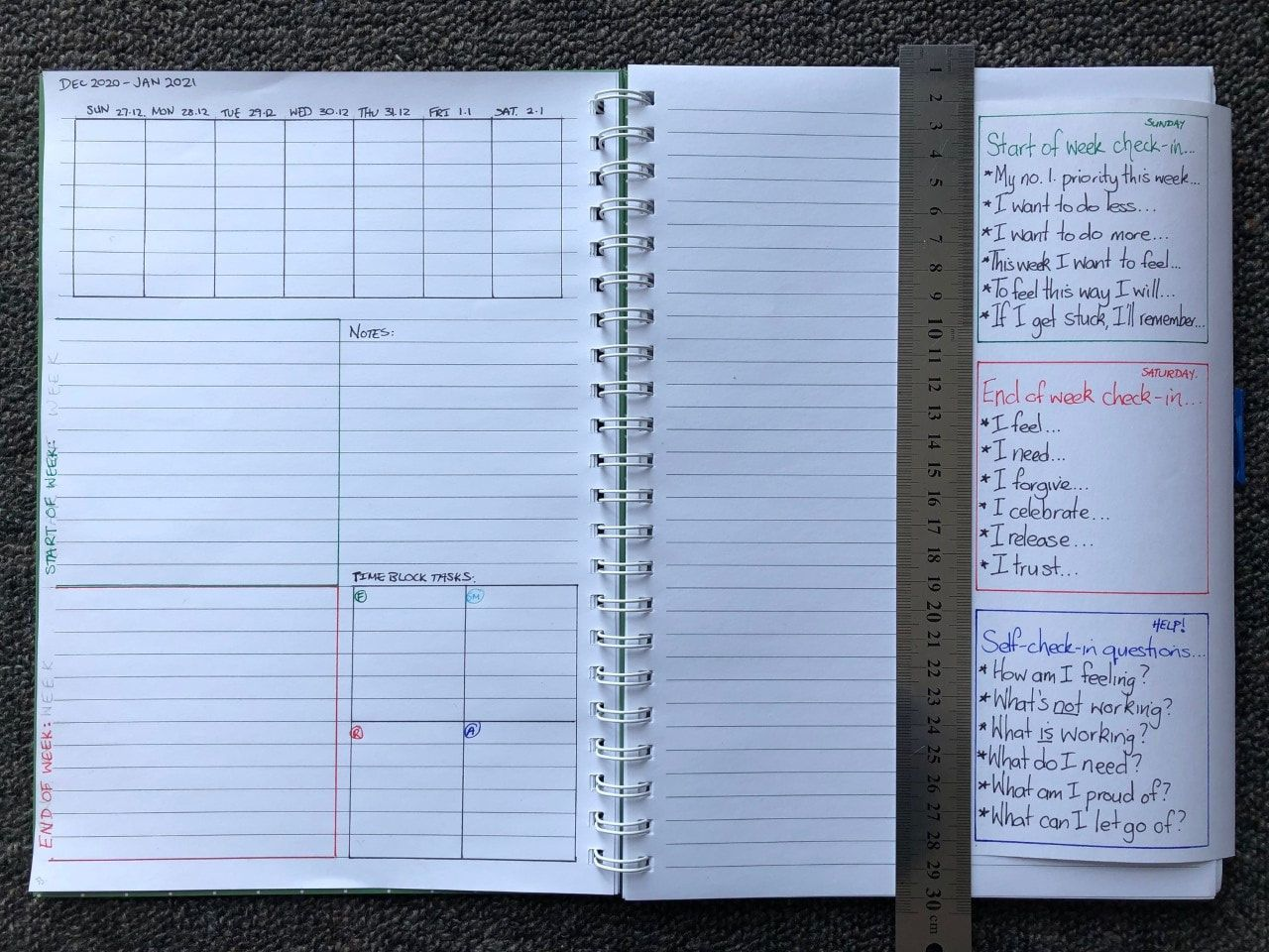 Illustrating how the Planner Foldout with tab can be tucked around open pages when in use.pages