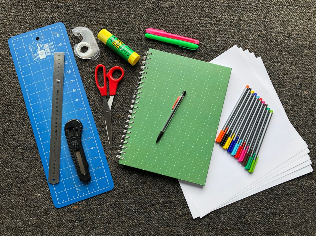 Image of materials needed, including: cutting mat, ruler, scissors or craft knife, tape and/or glue, journal, thick paper, pencil, coloued pens and highlighters to suit your tastes.
